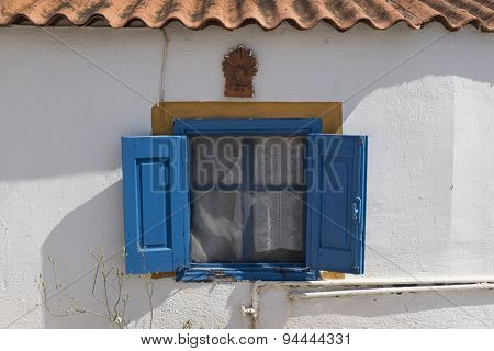Traditional old blue painted greek window