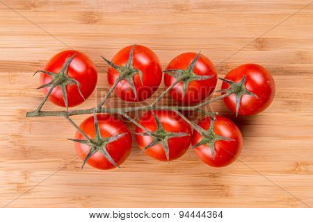 Tomato branch on vintage wood table.