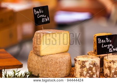 Chunks Of Different Cheeses At A Local French Market