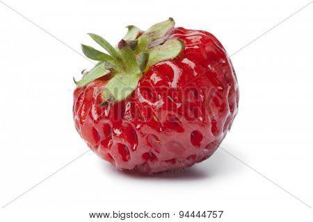 Single fresh ripe strawberry on white background
