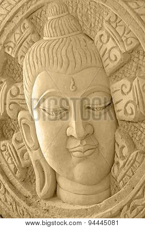 Thai Art Of Sand Sculpture Of Buddha Face Looks Kind And Peaceful.