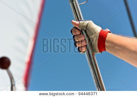 Sailors Hand On A Sailboat