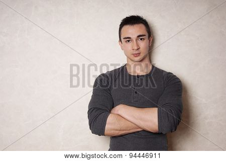 man with crossed arms