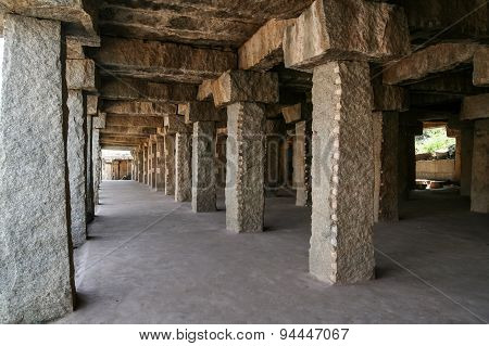 Stone pillar long corridor in hampi
