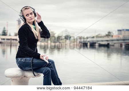 Girl with mobile phone and headphones
