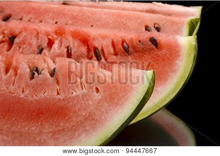 Closeup Macro Shot Of Slices Of Watermelon On Black