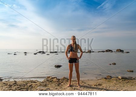 Sport woman posing on a beach