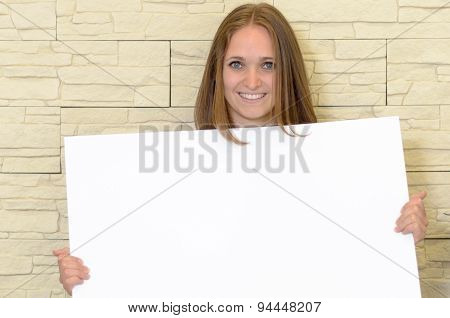 Pretty Woman Holding Up A Blank White Sign