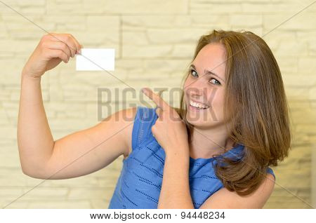 Cheerful Young Woman Holding A Small Blank Card