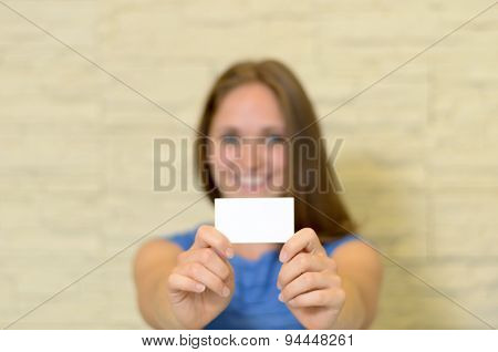 Young Woman Holding Out A Business Card