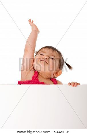 Happy Baby Holding White Board And Reaching Up