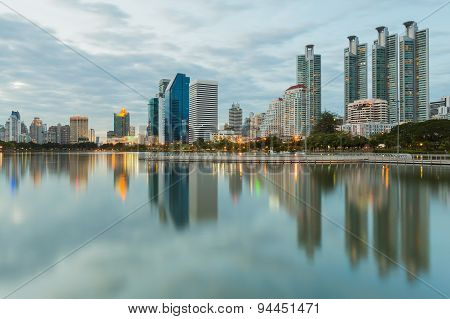Bangkok city downtown twilight with water reflection of skyline Benjakitti ParkBangkokThailand