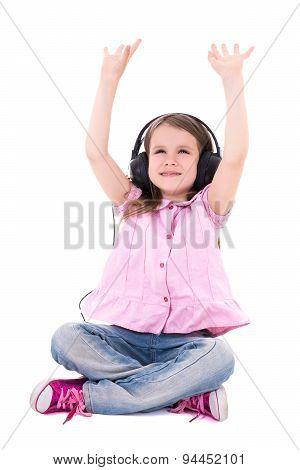 Cute Little Girl Enjoying Music In Headphones Isolated On White