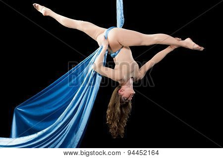 Young woman training on aerial silk