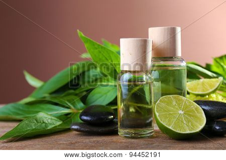 Spa still life in green color on wooden table on brown background