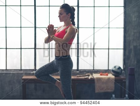 Woman In Profile Doing Yoga Tree Position