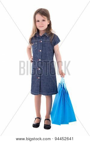 Cute Little Girl In Denim Dress With Shopping Bags Isolated On White