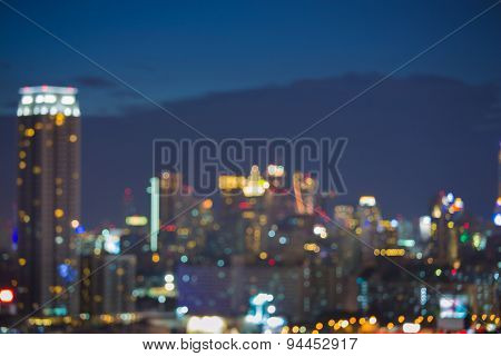 Bokeh of Bangkok skyline after sunset during the blue hour