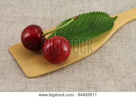 Abstract View Cherry On Wooden Spatula