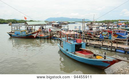 Tourists Waiting At The Pier For Boarding To Boat