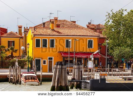 Burano. The Central Pier Of The Commune.