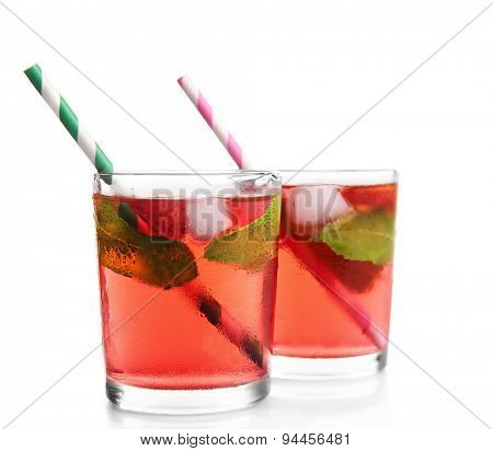 Glasses of strawberry juice isolated on white