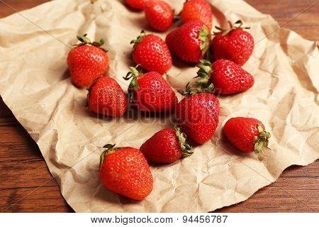 Ripe strawberries on crumples parchment, closeup