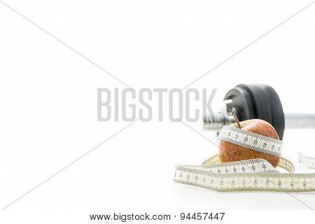 Close Up Of Apple, Measuring Tape And Dumbell