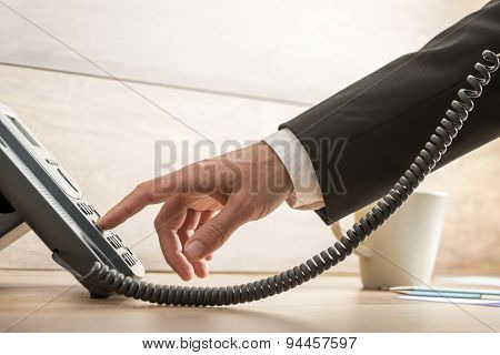Closeup Of Male Telemarketing Operator Dialing A Telephone Number