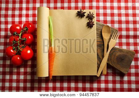 Open recipe book on tablecloth background