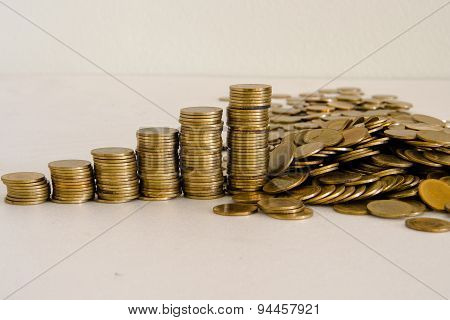 Stack of golden Thai coins isolated on white background