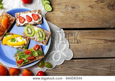 Still life with vegetarian sandwiches on wooden table