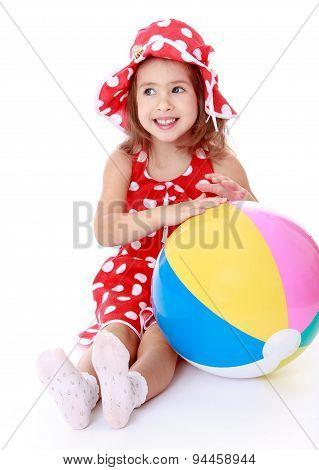 Happy joyful girl in a red polka dot