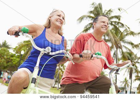 Senior Couple Having Fun On Bicycle Ride