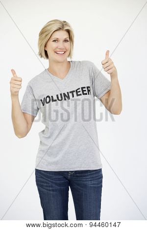 Portrait Of Female Volunteer Giving Thumbs Up