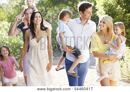 Two Families On Country Walk Together