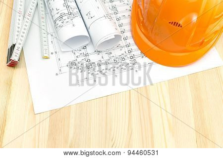 Construction Plans With Safety Helmet And Wooden Ruler