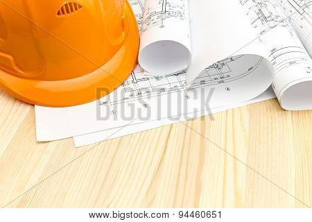 Orange Safety Helmet And Project Drawings