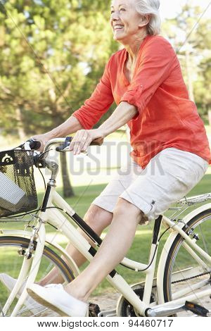 Senior Woman Enjoying Cycle Ride
