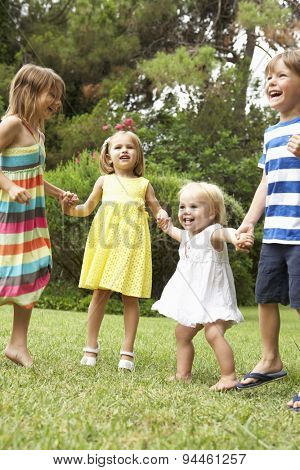 Group Of Children Playing Outdoors Together