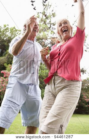 Energetic Senior Couple In Countryside