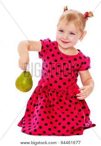 girl in garden collects pears