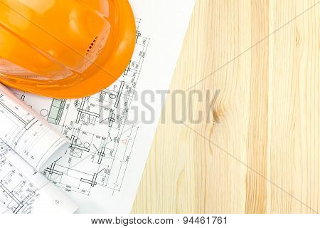 Floor Plan Drawings With Safety Helmet On Wooden Desk
