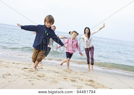 Family Playing On Beach Together