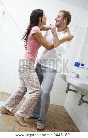 Couple Having Fun In Bathroom Brushing Teeth