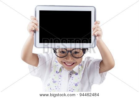 Female Kid With Tablet In Studio