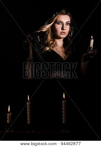 Scared Young Woman With A Candle