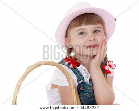 Cute blonde girl with short pigtails and hat smiling