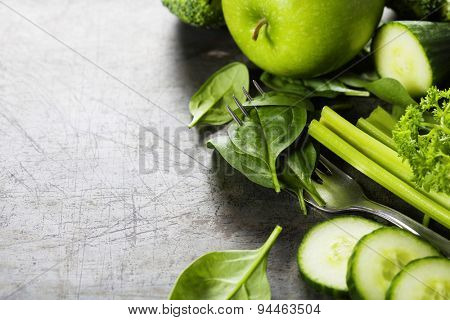 Fresh green vegetables on vintage background - detox, diet or healthy food concept