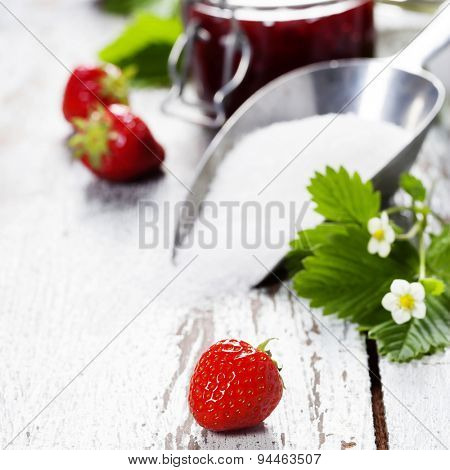 Strawberry jam in a jar on wooden background